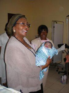 Edna Adan holding a newborn
