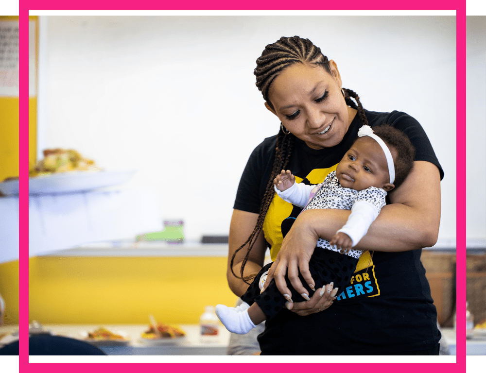 Black woman holding her baby girl