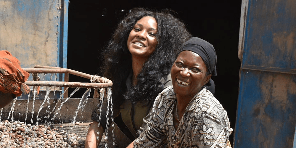 Christina Funke Tegbe pictured with another African woman washing grains