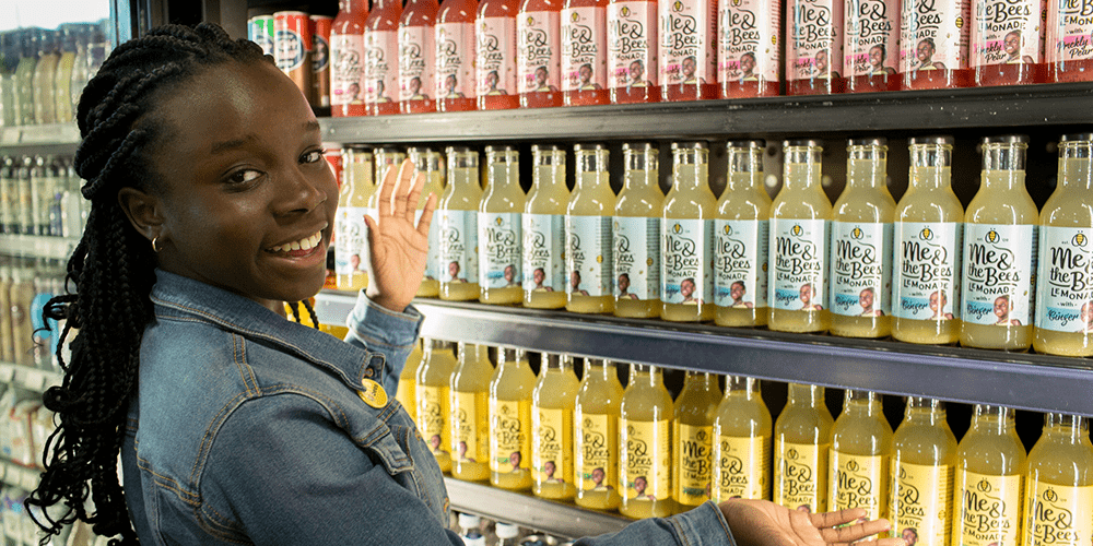 Mikaila Ulmer showing her product on a grocery store shelf