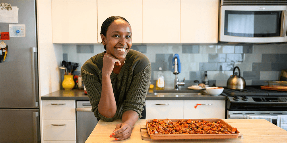 Portrait of Hawa Hassan in her kitchen