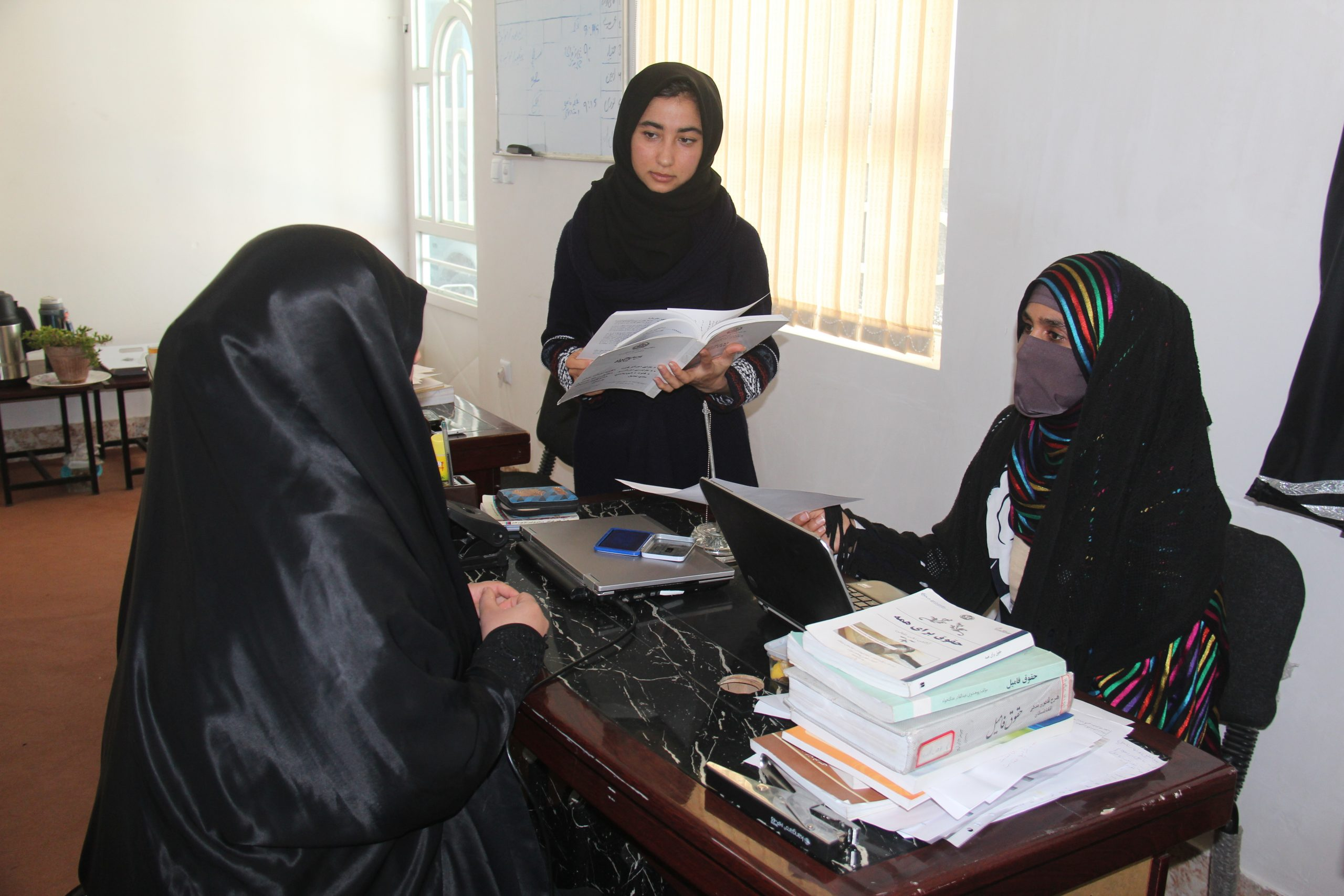 Woman meets with Lawyer and her assistant at a legal clinic for women in Afghanistan