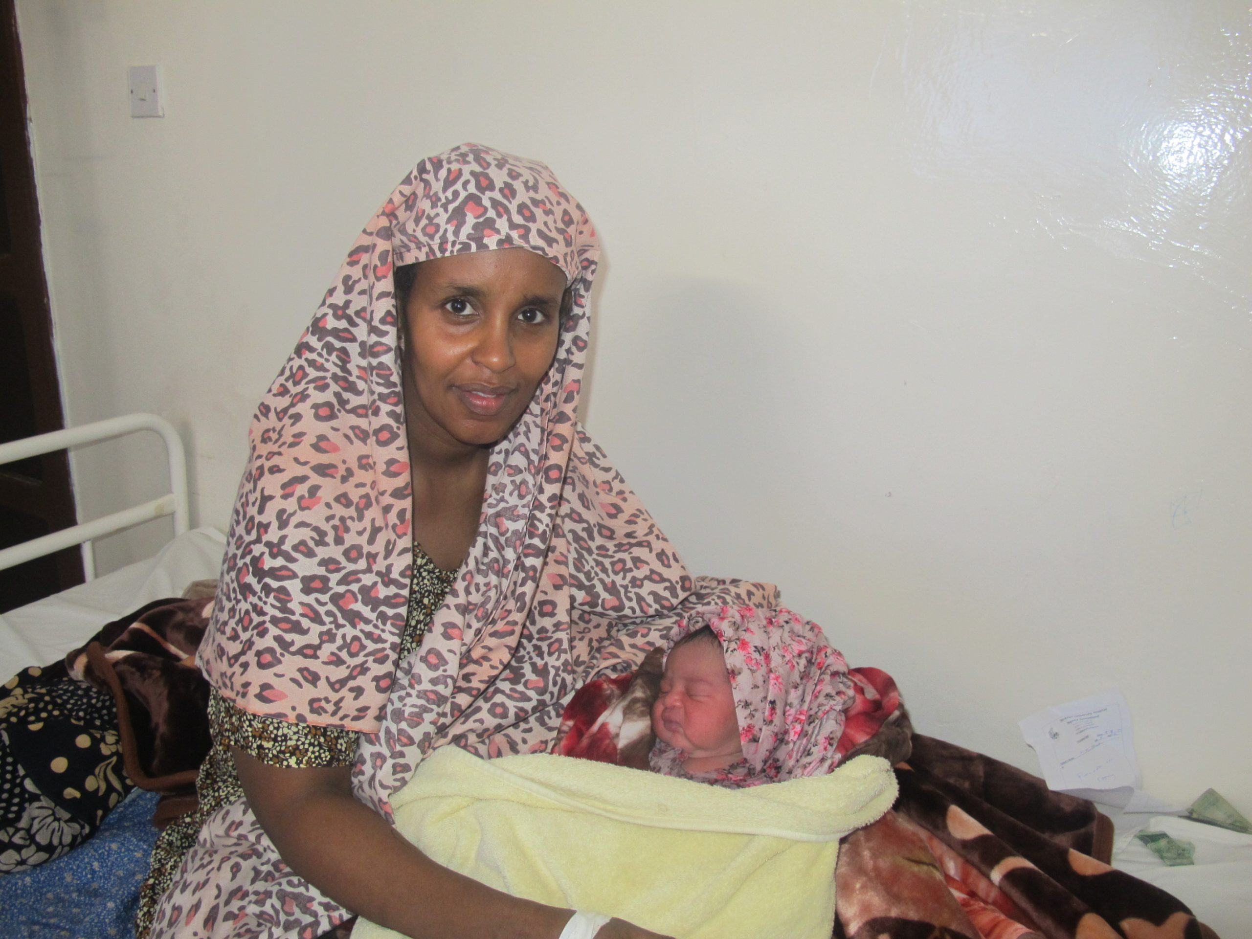 Young mother shows her new born baby to the camera at Edna Adan's Hospital in Somaliland